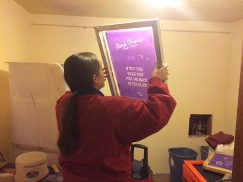 Kasey inspecting a screen